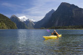 Man paddling kayak — Stock Photo