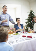 Family at christmas dinner — Stock Photo