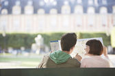 Couple looking at map in park — Stock Photo