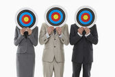 Business people holding targets — Stock Photo