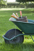 Wheelbarrow Full of Gardening Tools — Stock Photo