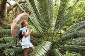 Girl Looking at Large Fern — Stock Photo