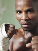 Boxer with raised fists — Stock Photo