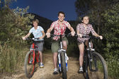 Boys and girl riding bicycles — Stock Photo
