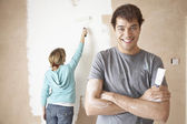 Couple painting interior wall — Stock Photo