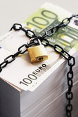 Stack of Euros secured by padlock — Stock Photo