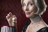 Senior Woman with candy — Stock Photo