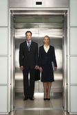 Businesspeople Side by Side in Elevator — Stock Photo