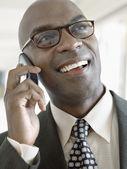 Businessman using phone — Stock Photo