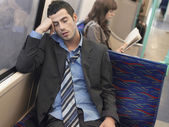 Businessman sleeping in  train — Stock Photo