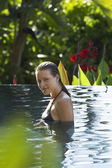 Woman in outdoor swimming pool — Stock Photo