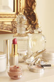 Table With Cosmetics and Wall Mirror — Stock Photo