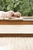 Woman lying on cushions — Stock Photo