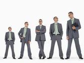 Businessmen in ascending order of height — Stock Photo