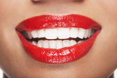 Woman's teeth and mouth with red lipstick — Stock Photo