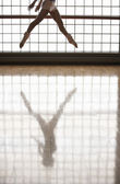 Ballerina in mid-air window and reflection — Stock Photo