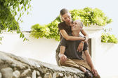 Tourist Couple on Stone Wall — Stock Photo