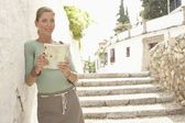 Woman with Guidebook — Stock Photo