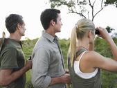 Men and woman with binoculars — Stock Photo