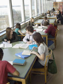 Students in reading room — Stock Photo