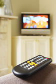 Remote Control and Flat-Screen Television — Stock Photo