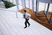Businessman Running up Stairs — Stock Photo