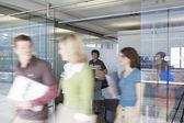 Office workers leaving conference room — Stock Photo