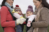 Mothers in park with babies — Stock Photo