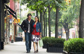 Couple walking on sidewalk — Stock Photo
