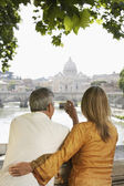 Couple photographing cathedral — Stock Photo
