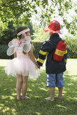 Fairy and fireman — Stock Photo