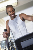 Man on elliptical machine — Stock Photo