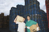 Warehouse Workers Carrying Boxes — Stock Photo