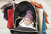 Baby sitting in stroller — Stock Photo