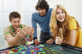 Man with friends at roulette table — Stock Photo