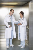 Physicians Discussing Chart — Stock Photo