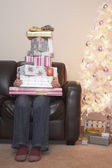 Person with stack of Christmas gifts — Stock Photo