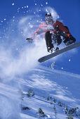 Snowboarder mid-air above ski — Stock Photo