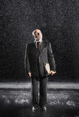 Rain falling on businessman — Stock Photo