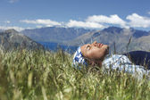 Man lying in field — Stock Photo