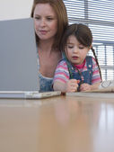Mother Using Laptop — Stock Photo