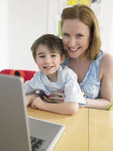 Mother and Son using Laptop — Stock Photo