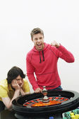 Man celebrating at roulette wheel — Stock Photo