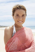 Woman in bikini and shawl — Stock Photo