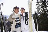 Skiing couple standing — Stock Photo