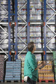 Warehouse Worker Checking Inventory — Stock Photo