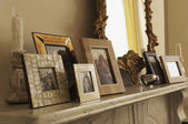 Fireplace Mantel With Framed Pictures — Stock Photo