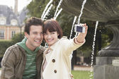 Couple photographing themselves — Stock Photo