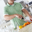 Man chopping peppers  — Stock Photo