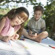 Young boy and girl drawing — Photo